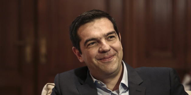 Greece's Prime Minister Alexis Tsipras, right, and visiting Cypriot President Nicos Anastasiadis address reporters during a news briefing in Athens, on Friday, April 17, 2015. Anastasiadis is on a one-day official visit to Greece.   (AP Photo/Yorgos Karahalis)