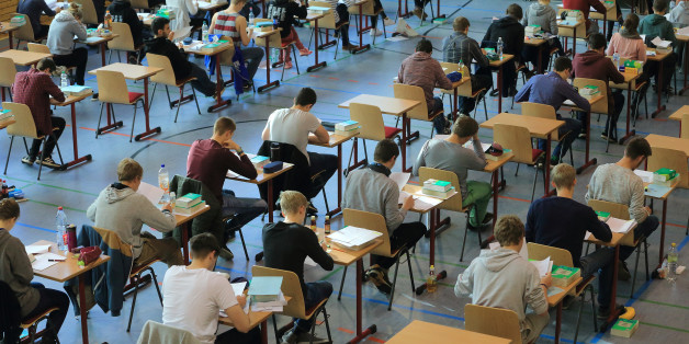 High school students sit at their tables during the final school leaving exams (Abitur) at the ecumenical Domgymnasium (high school) in Magdeburg, Germany, 29 April 2015. Around 5,600 high school students are taking their School leaving exams in Saxony-Anhalt until 11 May 2015. Photo: Jens Wolf/dpa