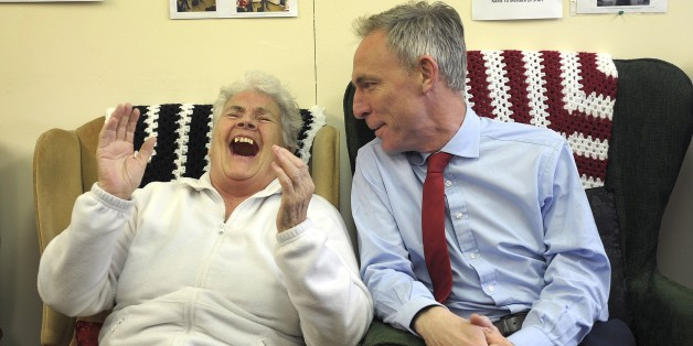 Leader of the Scottish Labour Party Jim Murphy (R) speaks with pensioner Margaret McLaughlin as he campaigns at the Donald Dewar Day Centre in the Yoker area of Glasgow in Scotland, on April 29, 2015, ahead of a general election in Britain on May 7, 2015. AFP PHOTO / ANDY BUCHANAN        (Photo credit should read Andy Buchanan/AFP/Getty Images)