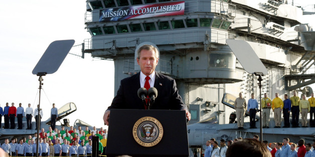 President George W. Bush declares the end of major combat in Iraq as he speaks aboard the aircraft carrier USS Abraham Lincoln off the California coast on May 1, 2003. (AP Photo/J. Scott Applewhite)