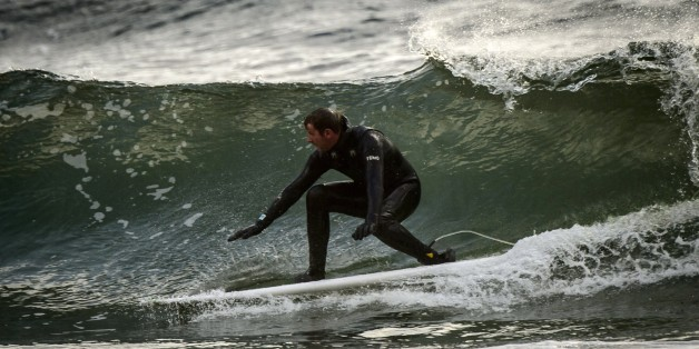 Norwegian Tommy Olsen surfs in Unstad, in the Lofoten Islands within the Arctic Circle, on April 18, 2015. Surfing in the Lofoten Islands has started early in the 60's, and is possible all year long in the Atlantic waters close to 5°C at winter time and and 11°C at summer time.  AFP PHOTO / OLIVIER MORIN        (Photo credit should read OLIVIER MORIN/AFP/Getty Images)