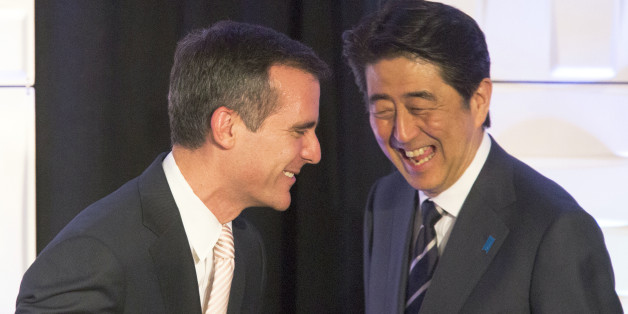 Los Angeles mayor Eric Garcetti, left, and Japanese Prime Minister Shinzo Abe share a laugh at the Investment Seminar reception at the Millennium Biltmore hotel in Los Angeles Friday, May 1, 2015. (David McNew/Pool via AP)