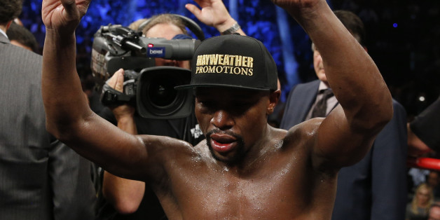 Floyd Mayweather Jr. celebrates after his welterweight title fight against Manny Pacquiao, from the Philippines, on Saturday, May 2, 2015 in Las Vegas.(AP Photo/John Locher)