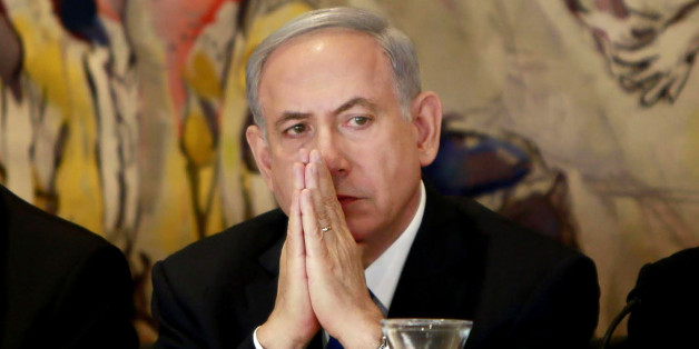 Israel's Prime Minister Benjamin Netanyahu listens during an event following the first session of the newly-elected Knesset in Jerusalem, Tuesday, March 31, 2015. (AP Photo/Gali Tibbon, Pool)
