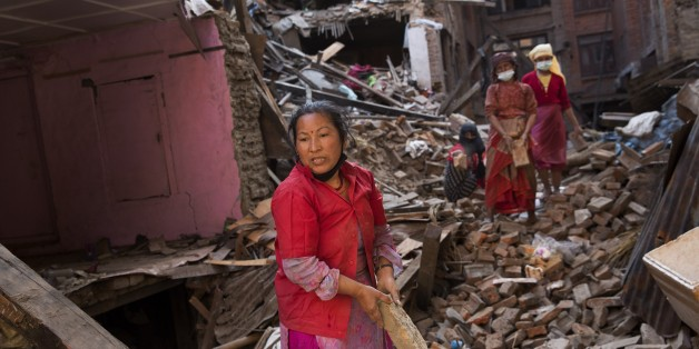 Nepalese women remove debris searching their belongings from their house that was destroyed a week ago during the earthquake in Bhaktapur, Nepal, Sunday, May 3, 2015. The true extent of the damage from the April 25 earthquake is still unknown as reports keep filtering in from remote areas, some of which remain entirely cut off. The U.N. says the quake affected 8.1 million people — more than a quarter of Nepal's 28 million people. (AP Photo/Bernat Amangue)