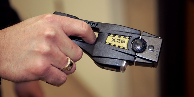 A Taser X26 stun gun is displayed at the Oakland Country Sheriff's office in Pontiac, Mich., Tuesday, Dec. 12, 2006. A little-noticed bill that would let more people use Tasers and stun guns in Michigan is awaiting Gov. Jennifer Granholm's signature, though critics hope she wields her veto pen. The legislation approved by the state Senate 30-7 last week would exempt detention facilities and private security officers at some hospitals and malls from a ban against Tasers, which have been criticize