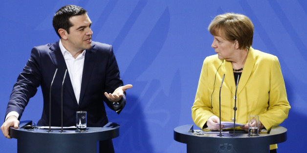 German Chancellor Angela Merkel, right, and the Prime Minister of Greece Alexis Tsipras brief the media during a bilateral meeting at the chancellery in Berlin, Monday, March 23, 2015. (AP Photo/Markus Schreiber)