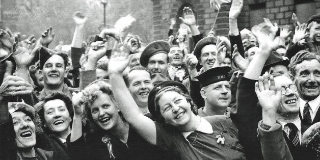 Jubilant crowds in Parliament Street celebrate the end of the war in Europe on the 8th May 1945.