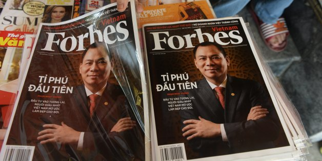 A copy of the newly launched Vietnamese version of Forbes Magazine is seen on sale at a roadside newsstand in Hanoi on June 26, 2013. The Southeast Asian communist nation's first Forbes-recognised billionaire Pham Nhat Vuong is on the cover of the inaugural issue.  AFP PHOTO/HOANG DINH Nam        (Photo credit should read HOANG DINH NAM/AFP/Getty Images)
