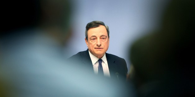 Mario Draghi, President of the European Central Bank (ECB) addresses the media during a press conference following the meeting of the Governing Council in Frankfurt/Main, Germany, on April 15, 2015. A news conference by European Central Bank president Mario Draghi in the bank's headquarters was briefly interrupted Wednesday when a young woman charged at Draghi calling for an 'end to the ECB dictatorship'. AFP PHOTO / DANIEL ROLAND        (Photo credit should read DANIEL ROLAND/AFP/Getty Images)