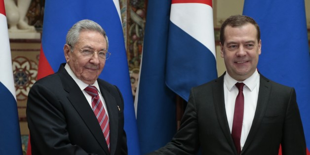 Russian Prime Minister Dmitry Medvedev, right, and Cuban President Raul Castro shake hands at their meeting in Moscow, Russia, Wednesday, May 6, 2015. (AP Photo/Ivan Sekretarev)