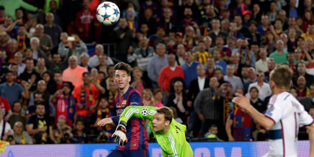 Barcelona's Lionel Messi, left scores his second goal past Bayern's goalkeeper Manuel Neuer during the Champions League semifinal first leg soccer match between Barcelona and Bayern Munich at the Camp Nou stadium in Barcelona, Spain, Wednesday, May 6, 2015.  (AP Photo/Emilio Morenatti)