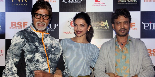 Indian Bollywood actors Amitabh Bachchan (L), Deepika Padukone (C) and Irrfan Khan pose for a photograph during a promotional event for the forthcoming Hindi film 'Piku' directed by Shoojit Sircar in Mumbai on late March 25, 2015. AFP PHOTO / STR        (Photo credit should read STRDEL/AFP/Getty Images)