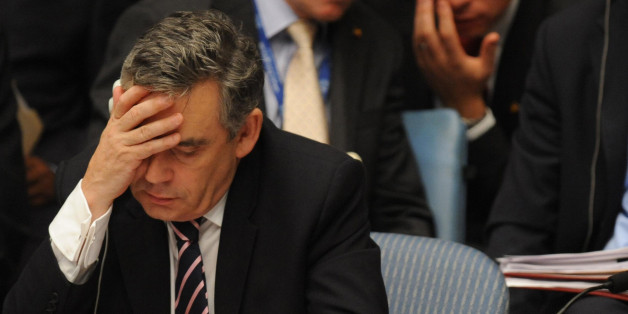 Britain's Prime Minister Gordon Brown prepares to speak at the UN Security Council in New York, while Britain's Foreign Secretary David Miliband looks on in the background.