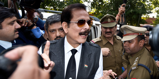 India's Sahara group chairman Subrata Roy (C) speaks to the media as he arrives at the Supreme Court in New Delhi.