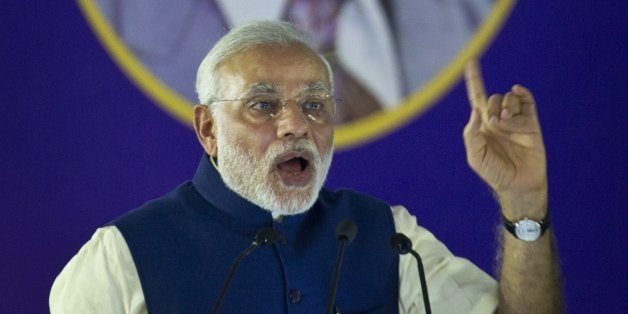 Indian Prime Minister Narendra Modi speaks after unveiling the foundation stone for an international center dedicated to Ambedkar, in New Delhi, India, Monday, April 20, 2015. Ambedkar, an untouchable, or Dalit, and a prominent Indian freedom fighter, was the chief architect of the Indian Constitution, which outlawed discrimination based on caste.(AP Photo/Saurabh Das)
