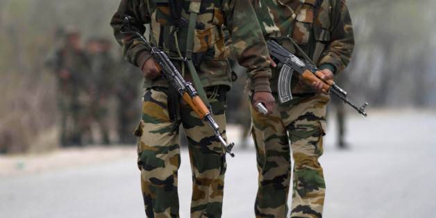 Indian army soldiers arrive at the site of a gunbattle in Srinagar, India, Wednesday, March 13, 2013. Two militants carrying guns and grenades attacked a group of paramilitary soldiers on the outskirts of the capital of Indian-controlled Kashmir on Wednesday morning, leaving five soldiers and both militants dead and 10 other people wounded, police said. It was the bloodiest militant attack in the capital in years. (AP Photo/Dar Yasin)