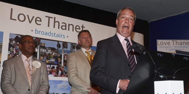 United Kingdom Independent Party (UKIP) leader Nigel Farage (R) speaks after he failed to be elected to the parliamentary seat of Thanet South in Margate, southeast England, on May 8, 2015 during the British general election. Farage announced his resignation as leader of the anti-EU UKIP after he failed to win a seat in Britain's parliament. AFP PHOTO / NIKLAS HALLE'N        (Photo credit should read NIKLAS HALLE'N/AFP/Getty Images)