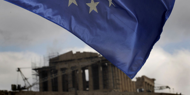 A European Union Flag flies in Athens, on Monday, Jan. 30, 2012 as the ancient Parthenon temple is seen in the background. EU leaders in Brussels  Monday are expected to consider the progress of negotiations with Greece for a major debt-relief deal and second bailout loan agreement. (AP Photo/Petros Giannakouris)