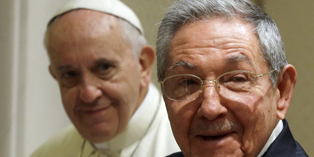 Pope Francis, left, looks at Cuban President Raul Castro during a private audience at the Vatican, Sunday, May 10, 2015. Cuban President Raul Castro has been welcomed at the Vatican by Pope Francis, who played a key role in the breakthrough between Washington and Havana aimed at restoring U.S.-Cuban diplomatic ties. (AP Photo/Gregorio Borgia, Pool)