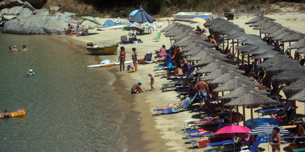 Photo taken on 23 July, 2013, shows a beach in Sikia, in Chalkidiki Peninsula some 650km north of Athens.Overall, international arrivals to Greece increased by 9.5 percent during the January-June 2013 period compared with the same period last year.Based on the above data and in view of the upcoming high summer season, industry professionals remained optimistic that this year's arrivals figures would hit the 17 million mark. AFP PHOTO /Sakis Mitrolidis        (Photo credit should read SAKIS MITROLIDIS/AFP/Getty Images)