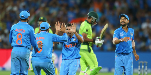 Mohammed Shami of India celebrates with his teammates after dismissing Wahab Riaz of Pakistan during the 2015 ICC Cricket World Cup match.