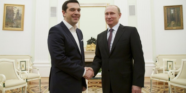 Russian President Vladimir Putin, right, welcomes visiting Greek Prime Minister Alexis Tsipras in Moscow's Kremlin, Russia, Wednesday, April 8, 2015. Alexis Tsipras is in Russia on an official visit.  (AP Photo/Alexander Zemlianichenko, Pool)