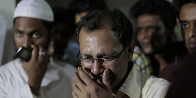 In this Monday, March 30, 2015 photo, a relative of the late Bangladeshi blogger Qyasiqur Rahman Babu cries outside a morgue at the Dhaka Medical College in Dhaka, Bangladesh. The blogger, 27, was hacked to death by three men in Bangladesh's capital on Monday, police said. The killing took place a month after a prominent Bangladeshi-American blogger known for speaking out against religious extremism was hacked to death in Dhaka. (AP Photo/A.M. Ahad)