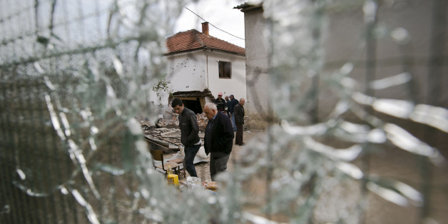 Residents visit the neighborhood where a battle took place over the weekend involving the police and an armed group, in northern Macedonian town of Kumanovo, early Monday, May 11, 2015. (AP Photo/Visar Kryeziu)
