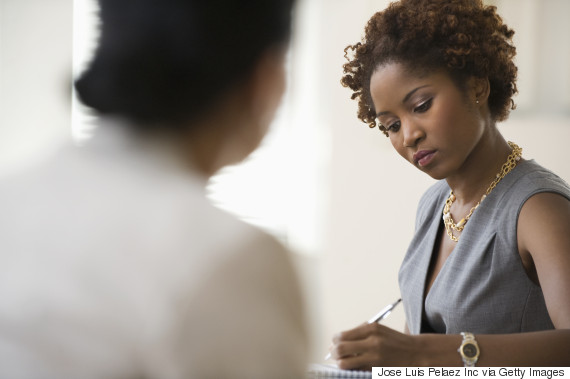 black woman office meeting serious