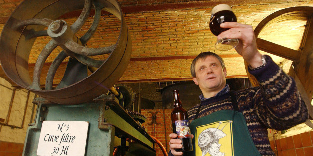 Francois Tonglet, owner of the Caracole brewery, holds up a glass of his own brew in Falmignoul, Belgium, March 9, 2004. Tonglet, along with co-owner Jean-Pierre Debras, produce nearly 39,000 gallons of beer each year in their small brewery with buildings dating back to the 1820's. (AP Photo/Geert Vanden Wijngaert)