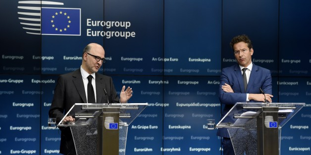 EU Commissioner of Economic an d Financial Affairs, Taxation and Customs Pierre Moscovici (L) and Dutch Finance Minister and president of Eurogroup Jeroen Dijsselbloem give a joint press conference after an Eurogroup Council meeting on May 11, 2015  at EU Headquarters in Brussels. AFP PHOTO/JOHN THYS        (Photo credit should read JOHN THYS/AFP/Getty Images)