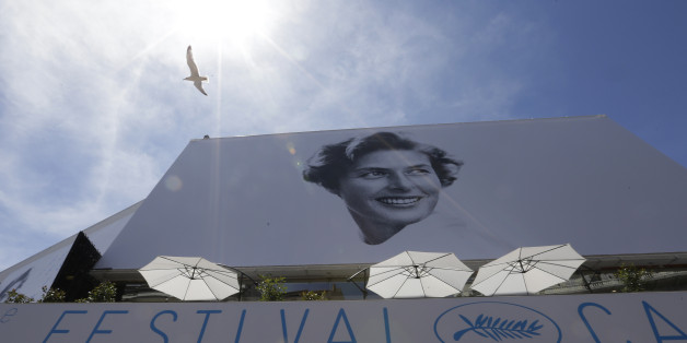 A bird flies past the official banner depicting actress Ingrid Bergman outside the Palais des Festivals ahead of the 68th international film festival, Cannes, southern France, Tuesday, May 12, 2015. The festival opens on Wednesday, May 13 and runs until Sunday, May 24. (AP Photo/Lionel Cironneau)