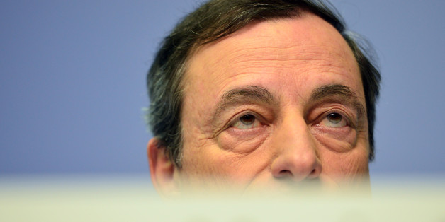FRANKFURT AM MAIN, GERMANY - DECEMBER 04:  Mario Draghi, President of the European Central Bank pictured during his first press conference following the monthly ECB board meeting in the new ECB headquaters on December 4, 2014 in Frankfurt am Main, Germany. ECB employees have moved into their new offices in recent months and the ECB has announced it will celebrate the building's official inauguration in 2015.  (Photo by Thomas Lohnes/Getty Images)