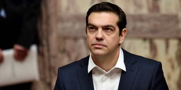 Greek Prime Minister Alexis Tsipras looks on during the swearing in ceremony of the New Greek President Prokopis Pavlopoulos (Unseen) in the parliament in Athens on March 13, 2015. AFP PHOTO / POOL / ARIS MESSINIS        (Photo credit should read ARIS MESSINIS/AFP/Getty Images)