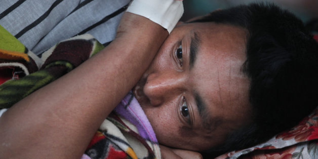 A Nepalese victim of an earthquake rests at Teaching Hospital in Kathmandu, Nepal, Tuesday, May 12, 2015. A major earthquake has hit Nepal near the Chinese border between the capital of Kathmandu and Mount Everest less than three weeks after the country was devastated by a quake. (AP Photo/Niranjan Shrestha)