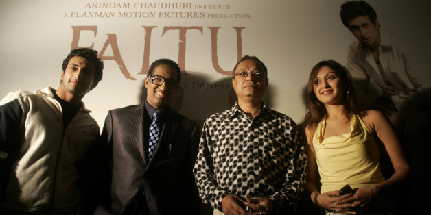 From left to right, actor Yash Pandit, producer Arindam Chaudhuri, director Anjan Das and actress Manjari Fadnis pose for a photograph at a press conference held to announce the release of their new Bengali film Faltu in New Delhi, on Thursday Feb 9, 2006.