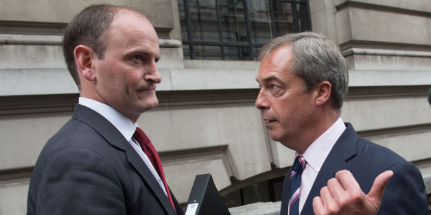 UKIP leader Nigel Farage (right) with Douglas Carswell after a press conference in central London where the Conservative MP defected to his party today.