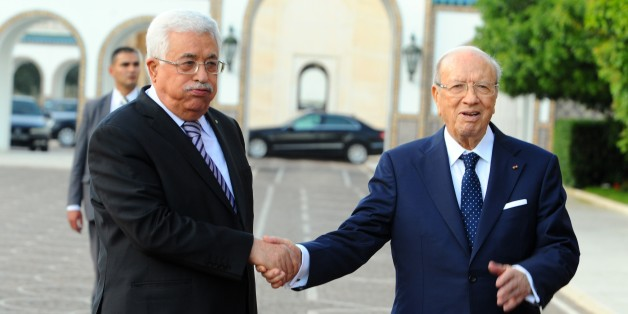 Tunisian President Beji Caid Essebsi, right, shakes hands with his Palestinian counterpart, Mahmoud Abbas, at the presidential palace in Carthage outside Tunis. Tuesday, May 12, 2015. (AP Photo/Hassene Dridi)