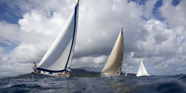 In this picture taken on May 1, 2015 shows boats racing in the twelfth edition of the Tahiti Pearl Regatta, which was held from April 30 to May 3, 2015, in the South Pacific. Over the years, the Tahiti Pearl Regatta has become the largest  Pacific Islands regatta. The route takes the boats between the islands of Raiatea, Bora Bora, Huahine and Tahaa. AFP PHOTO / GREGORY BOISSY        (Photo credit should read GREGORY BOISSY/AFP/Getty Images)