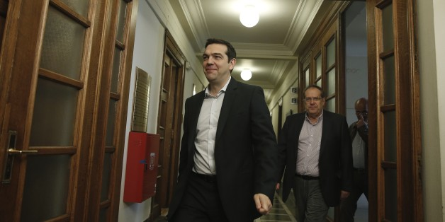 Greek Prime Minister Alexis Tsipras arrives at a cabinet meeting in central Athens, on Tuesday, May 12, 2015. Officials say Greece has completed a 757 million euro ($844 million) debt payment to the International Monetary Fund, despite an acute cash shortage that could come to a head within the next two weeks. (AP Photo/Petros Giannakouris)