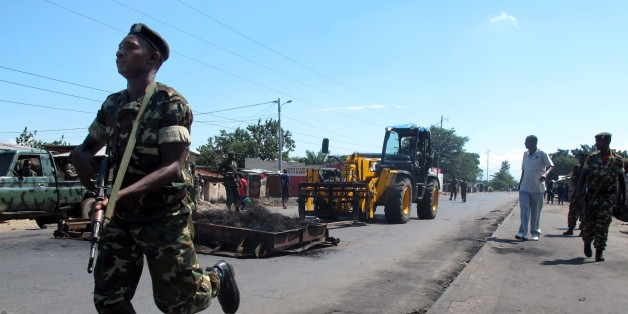 Members of the military escort a forklift as barricades erected by demonstrators are removed in the Cibitoke district of Bujumbura on May 10, 2015. Burundi's security forces began clearing barricades in the capital Bujumbura on May 10 after the government ordered an immediate end to protests against President Pierre Nkurunziza's controversial bid for a third term. AFP PHOTO / AYMERIC VINCENOT        (Photo credit should read AYMERIC VINCENOT/AFP/Getty Images)