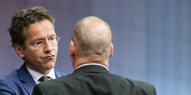 Dutch Finance Minister Jeroen Dijsselbloem, left, speaks with Greek Finance Minister Yanis Varoufakis during a round table meeting of the eurogroup finance ministers at the EU Council building in Brussels on Monday, May 11, 2015. Hopes for a deal between Greece and its European creditors at a key meeting Monday are slim, weighing on the region's stock markets as the country struggles to make upcoming debt repayments. (AP Photo/Geert Vanden Wijngaert)