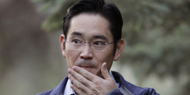 """Samsung Electronics Chief Operating Officer Lee Jae-yong """"Jay Lee"""" arrives at the Allen & Company Sun Valley Conference in Sun Valley, Idaho, Friday, July 13, 2012. (AP Photo/Paul Sakuma)"""