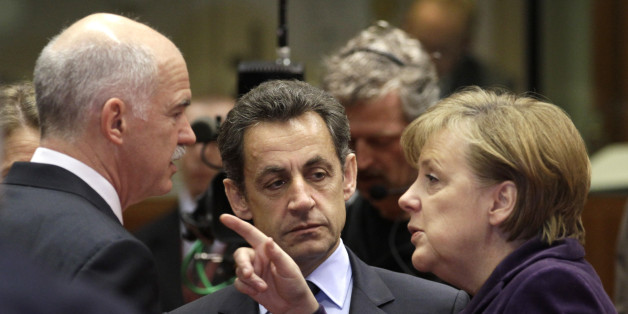 German Chancellor Angela Merkel, right, speaks with Greek Prime Minister George Papandreou, left, and French President Nicolas Sarkozy during a round table meeting at an EU summit in Brussels, Friday, Feb. 4, 2011. EU leaders meet for a one-day summit on Friday, with energy, the eurozone debt crisis and unrest in Egypt set to dominate the agenda. (AP Photo/Yves Logghe)