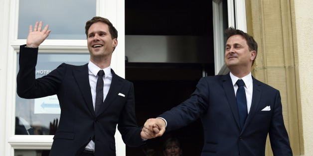 Luxembourg Prime Minister Xavier Bettel (R) holds hands with his companion Belgian architect Gauthier Destenay during their wedding in Luxembourg on May 15, 2015. Luxembourg Prime Minister Xavier Bettel is to wed his gay partner today, becoming the first European Union leader to enter into a same-sex marriage, a symbol of growing social change across the continent. AFP PHOTO / JOHN THYS        (Photo credit should read JOHN THYS/AFP/Getty Images)