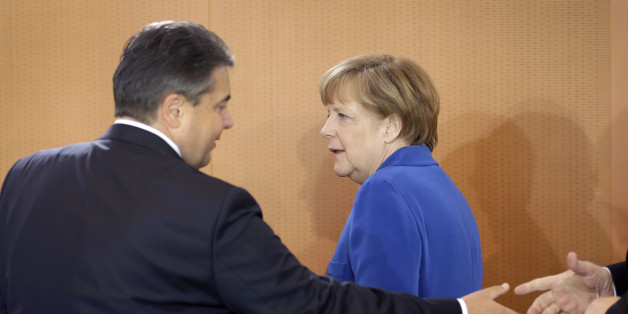 German Chancellor Angela Merkel, right, and Vice Chancellor and Economy Minister Sigmar Gabriel, left, arrive for the weekly cabinet meeting at the chancellery in Berlin, Germany, Wednesday, May 6, 2015. (AP Photo/Michael Sohn)