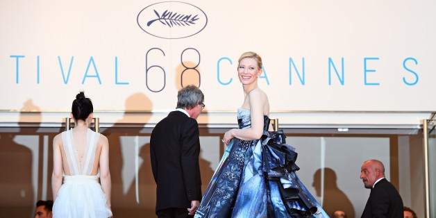 Australian actress Cate Blanchett (R) smiles as she arrives with US actress Rooney Mara (L) and US director Todd Haynes (C) for the screening of the film 'Carol' at the 68th Cannes Film Festival in Cannes, southeastern France, on May 17, 2015. AFP PHOTO / ANNE-CHRISTINE POUJOULAT        (Photo credit should read ANNE-CHRISTINE POUJOULAT/AFP/Getty Images)