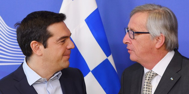 Greece's Prime Minister Alexis Tsipras (L) is welcome by European Commission President Jean-Claude Juncker at the European Commission in Brussels on March 13, 2015. Tsipras is in Brussels for talks on Athens' debt-hit bailout. AFP PHOTO/Emmanuel Dunand        (Photo credit should read EMMANUEL DUNAND/AFP/Getty Images)