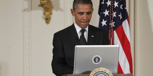 "President Barack Obama uses a laptop computer to send a tweet during a ""Twitter Town Hall"" in the East Room of the White House in Washington, Wednesday, July 6, 2011. (AP Photo/Charles Dharapak)"
